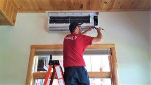 Aaron and Alyza Job Pics - Tech Aaron installing a Daikin mini split head